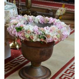 Cristelnita cu flori roz pe suport de burete